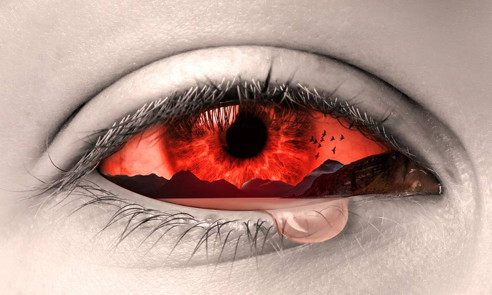 Crying eye with fantasy landscape superimposed