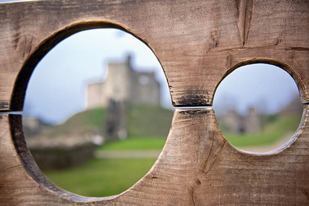 Two circles showing a castle in the background, framing the scenery.