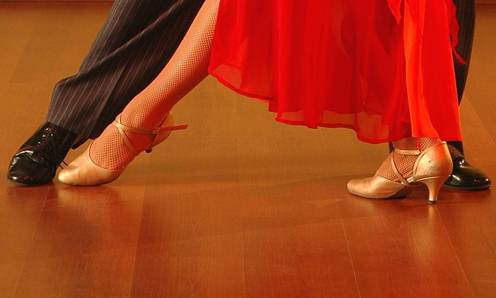 The feet of two Latin dancers doing a tango.