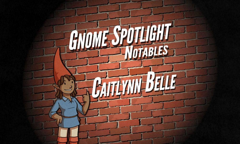The gnome spotlight header, a daker skinned female gnaome gives a thumbs up in front of a brink wall in a spotlight. The text reads Gnome Spotlight Notables - Caitlynn Belle