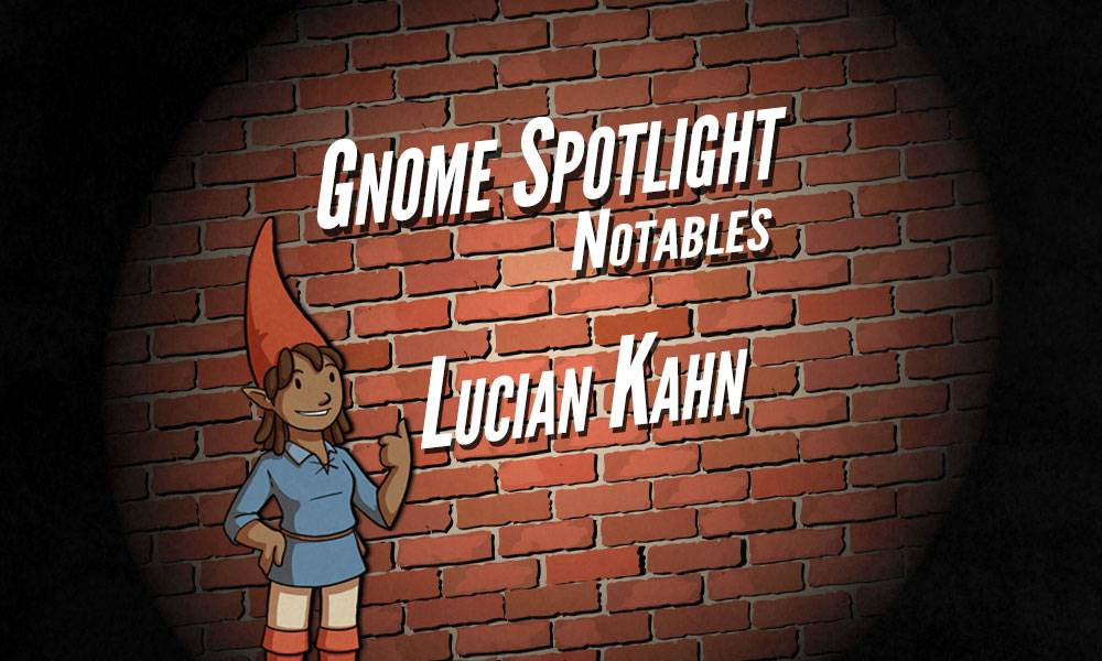 The gnome spotlight header, a daker skinned female gnaome gives a thumbs up in front of a brink wall in a spotlight. The text reads Gnome Spotlight Notables - Lucian Kahn