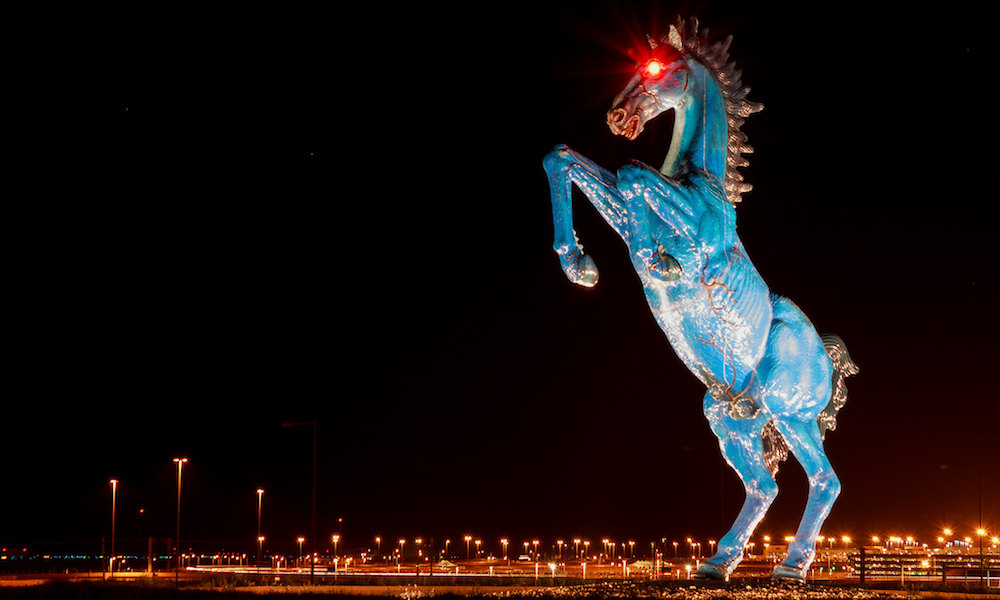 Blue Mustang statue at Denver International Airport -- a large blue mustang, rearing, with glowing red eyes