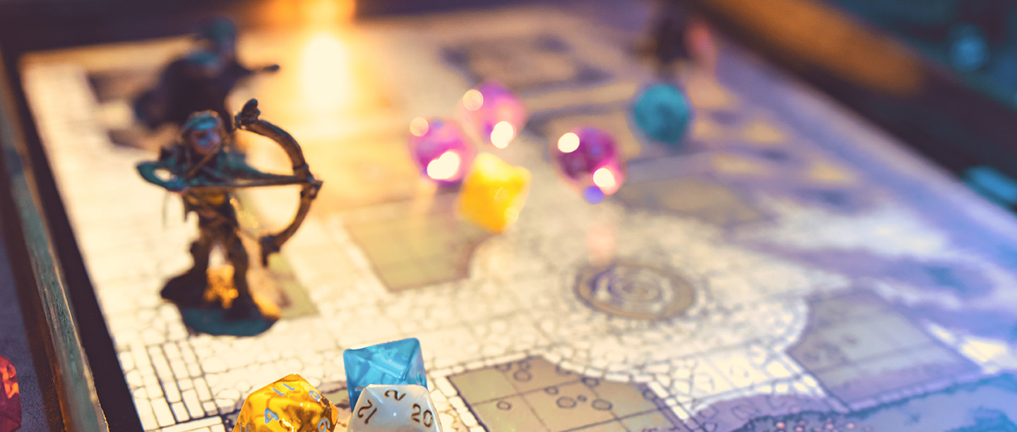 Dice and miniatures sit on top of a digital map