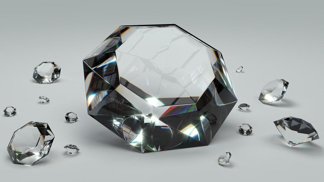 One large diamond and several smaller ones on a grey background.